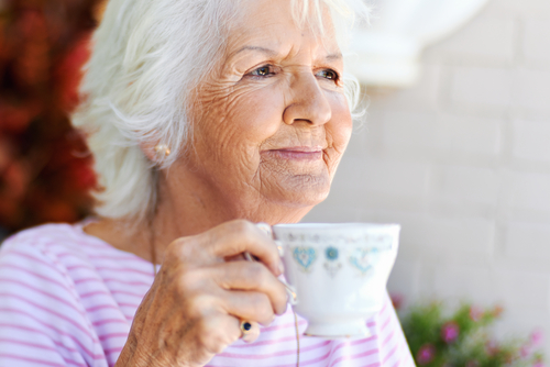 A peaceful senior woman keeping stress at bay by staying in assisted living in Maryland.