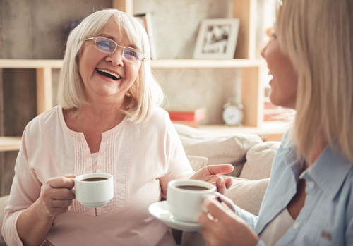 A happy elderly woman sitting with her daughter, talking pleasantly - Preparing Your Loved Ones for Assisted Living