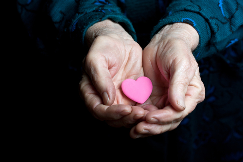 A heart in the hands of an elder - 3 Reasons Why Seniors Benefit from Assisted Living